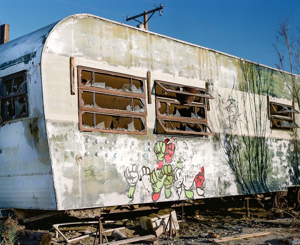 Abandoned trailer with colorful graffiti