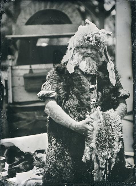 Mountain man reenactor dressed in animal skins