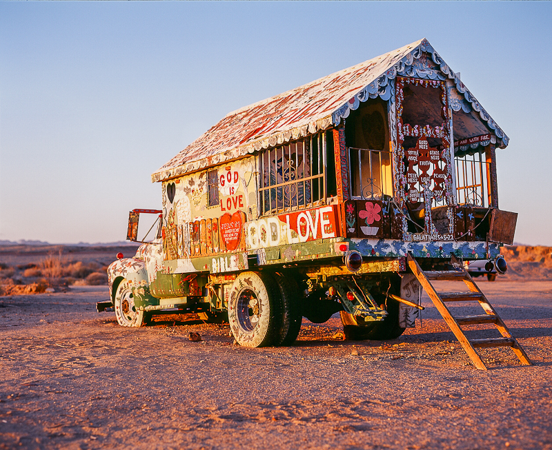 Salvation Mountain painted truck says God Love